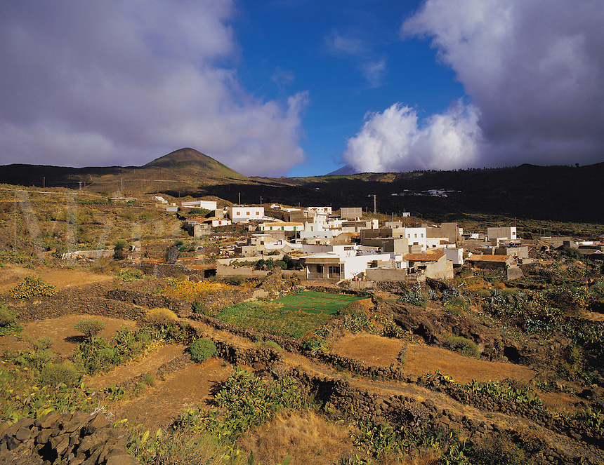 Hill village near Santiago del Teide with Mount Teide in cloud behind, Tenerife, Canary island