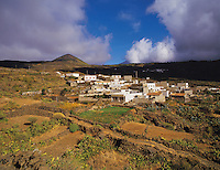Hill village near Santiago del Teide with Mount Teide in cloud behind, Tenerife, Canary island