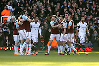 Pictured:  Kevin Nolan of West Ham (C) celebrating his opening goal with team mates. 01 February 2014<br />