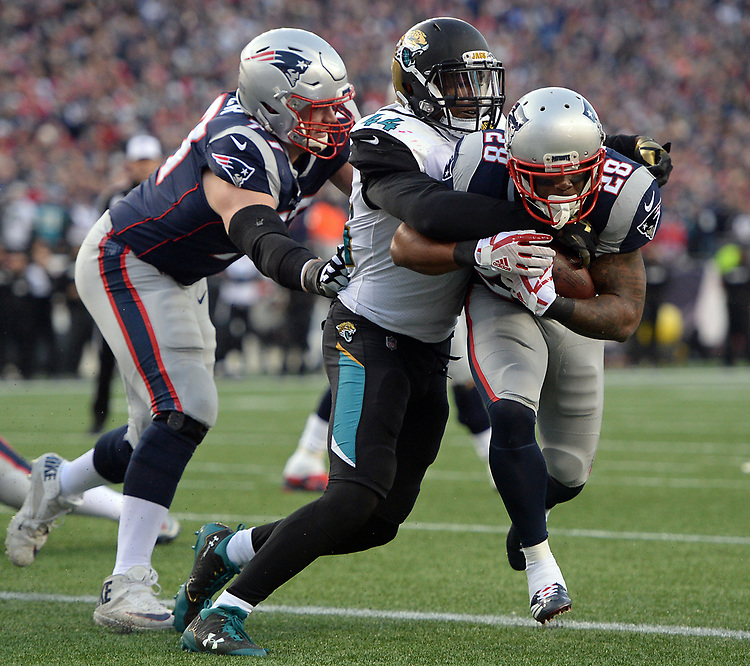 (Foxboro, MA, 01/21/18) New England Patriots running back James White, rights, scores a touchdown past Jacksonville Jaguars' Myles Jack as Patriots' Nate Solder, left, pushes White into the end zone during the second quarter of the AFC championship NFL football game at Gillette Stadium on Sunday, January 21, 2018. Photo by Christopher Evans