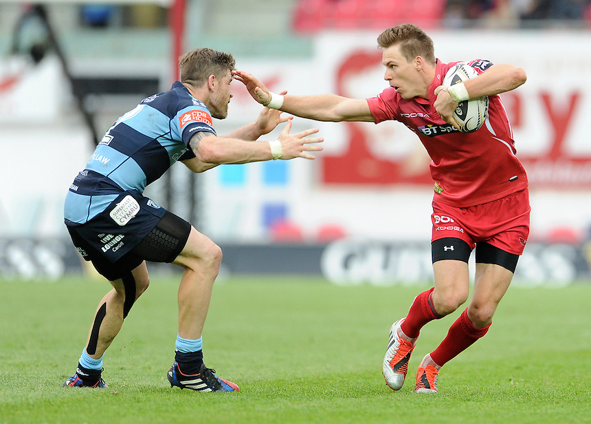 Scarlets' Liam Williams palms off Cardiff Blues' Gavin Evans<br /> <br /> Photographer Ian Cook/CameraSport<br /> <br /> Rugby Union - Guinness PRO12 - Scarlets v Cardiff Blues - Sunday 10th May 2015 - Parc y Scarlets - Llanelli<br /> <br /> &copy; CameraSport - 43 Linden Ave. Countesthorpe. Leicester. England. LE8 5PG - Tel: +44 (0) 116 277 4147 - admin@camerasport.com - www.camerasport.com