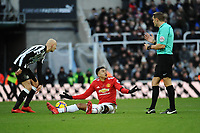 Jesse Lingard of Manchester United complains to referee Craig Pawson during Newcastle United vs Manchester United, Premier League Football at St. James' Park on 11th February 2018