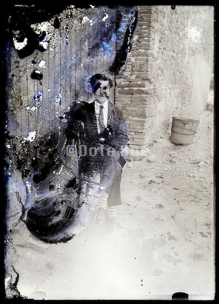 eroding glass plate photo of a a sitting adult man