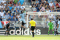 Kansas City forward Kei Kamara (23) scores what turned out to be the winning goal... Sporting Kansas City defetaed San Jose Earthquakes 2-1 at LIVESTRONG Sporting Park, Kansas City, Kansas.
