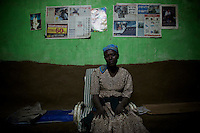"""Marie Negussie Lulat, 40 years old, poses in front of old Isreali newspaper pages in her home   in Walleke, once an Ethiopian Jewish town in the outskirts of the city of  Gonder, northern Ethiopia on Saturday January 10 2009. Marie says that her mother was a Jew and her father a Christian. She now sells souvenirs, mostly locally made pottery to interested visitors..Ethiopian Jews, who in the past were not allowed to own land, most of which was in the hands of the Orthodox church become able craftsmen producing pottery and threading cotton. All of them were airlifted to Israel through the years and none of them remains today in Walleke. Today the town is a tourist destination for whom are interested in The Beta Israelis and their history...Gonder hosts a population of around 9000 so called """"Falash Mura"""", supposed Ethiopian Jews who  were forced to convert to Christianity. The Israeli Government is still verifying their claims  and if a clear link between them and Israel would be established they would have the right to return to their mother land. In the mean time Israeli and other Jewish non governmental organizations are working in support of this community."""