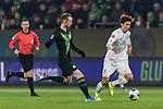 01.12.2019, Volkswagen Arena, Wolfsburg, GER, 1.FBL, VfL Wolfsburg vs SV Werder Bremen<br /><br />DFL REGULATIONS PROHIBIT ANY USE OF PHOTOGRAPHS AS IMAGE SEQUENCES AND/OR QUASI-VIDEO.<br /><br />im Bild / picture shows<br />Maximilian Arnold (VfL Wolfsburg #27), <br />Yuya Osako (Werder Bremen #08), <br /><br />Foto © nordphoto / Ewert