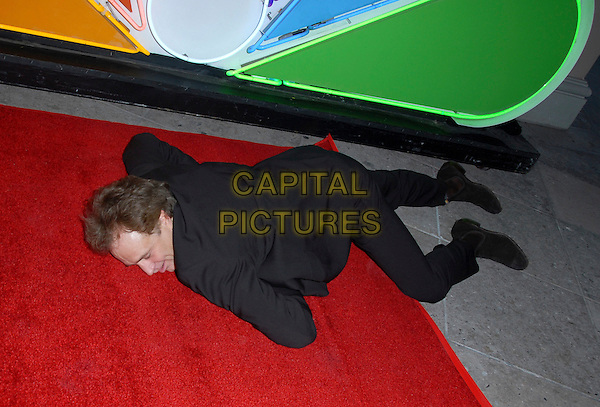 BRADLEY WHITFORD.The NBC All Star Party held at The Ritz Carlton in Pasadena, California .January 22nd, 2006.Ref: DVS.full length black suit sleeping on floor laying funny resting.www.capitalpictures.com.sales@capitalpictures.com.Supplied By Capital PIctures