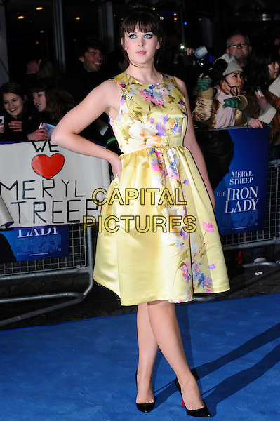 Alexandra Roach.'The Iron Lady' European Film Premiere at BFI cinema, Southbank, London, England..4th January 2012.full length yellow dress sleeveless silk satin floral print hand on hip .CAP/CJ.©Chris Joseph/Capital Pictures.