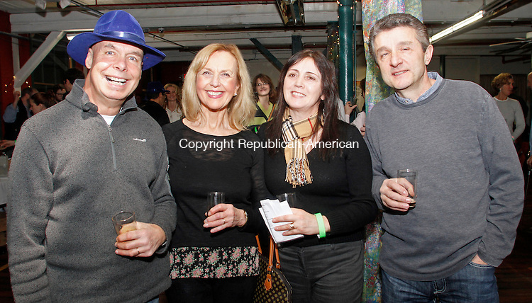 Winsted, CT-011814MK22 (from left) Marty nad Janice Conner, from Torrington, and Hena and Edmand Meto, from Goshen, gathered during the first annual Pints for a Purpose beer tasting and a concert to benefit the Northwest YMCA's Strong Kids campaign at Whiting Mills Saturday night in Winsted. Winsted YMCA branch director Jay Cohen said over a hundred beer enthusiasts came to enjoy seventeen local breweries and the proceeds will benefit the local community and families in need. Michael Kabelka / Republican-American