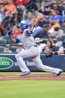 Chicago Cubs second baseman Addison Russell (22) swings at a pitch during a game against the Atlanta Braves on July 18, 2015 in Atlanta, Georgia. The Cubs defeated the Braves 4-0. (Tony Farlow/Four Seam Images)