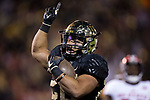 Matt Colburn II (22) of the Wake Forest Demon Deacons celebrates after scoring a touchdown during first half action against the North Carolina State Wolfpack at BB&T Field on November 18, 2017 in Winston-Salem, North Carolina.  (Brian Westerholt/Sports On Film)
