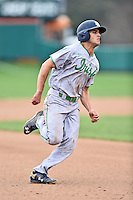 Notre Dame Fighting Irish left fielder Jake Johnson (39) runs to third during a game against the Clemson Tigers during game one of a double headers at Doug Kingsmore Stadium March 14, 2015 in Clemson, South Carolina. The Tigers defeated the Fighting Irish 6-1. (Tony Farlow/Four Seam Images)