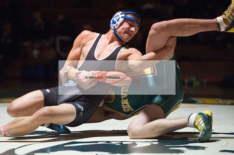 Chugiak's Brandon Lowe works out of a hold during his loss to Mario Herrera.   Photo for the Star by Michael DInneen