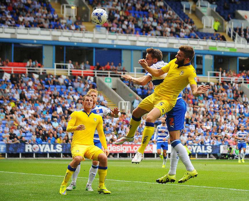 Leeds United's Stuart Dallas, under pressure from Reading's Chris Gunter, puts his header over the bar<br /> <br /> Photographer Kevin Barnes/CameraSport<br /> <br /> Football - The Football League Sky Bet Championship - Reading v Leeds United - Sunday 16th August 2015 - Madejski Stadium - Reading<br /> <br /> &copy; CameraSport - 43 Linden Ave. Countesthorpe. Leicester. England. LE8 5PG - Tel: +44 (0) 116 277 4147 - admin@camerasport.com - www.camerasport.com