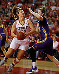 VERMILLION, SD - MARCH 24, 2016 -- Margaret McCloud #30 of South Dakota drives around Jen Keitel #42 of Northern Iowa during their WNIT game Thursday evening at the Dakotadome in Vermillion, S.D.  (Photo by Dick Carlson/Inertia)