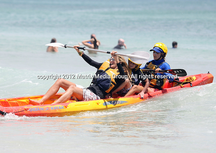 29/12/2011. Sydney, Australia...NON EXCLUSIVE..Elle Macpherson spends some quality time with her boys while on a family holiday in Byron Bay - Elle took the boys Ocean Kayaking.  29/12/2011. Sydney, Australia...NON EXCLUSIVE..Elle Macpherson spends some quality time with her boys while on a family holiday in Byron Bay - Elle took the boys Ocean Kayaking.  ..*No internet without clearance*.MUST CALL PRIOR TO USE ..02 9211-1088.Matrix Media Group.Note: All editorial images subject to the following: For editorial use only. Additional clearance required for commercial, wireless, internet or promotional use.Images may not be altered or modified. Matrix Media Group makes no representations or warranties regarding names, trademarks or logos appearing in the images.