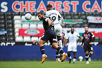 Cameron Carter-Vickers of Luton Town under pressure from Rhian Brewster of Swansea City during the Sky Bet Championship match between Swansea City and Luton Town at the Liberty Stadium in Swansea, Wales, UK. Saturday 27 June 2020.