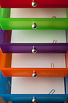 Mulicolored office drawers close-up views of colorful drawers with paper and colorful paper clips