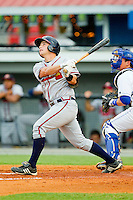 Casey Kalenkosky (12) of the Danville Braves follows through on his swing against the Burlington Royals at Burlington Athletic Park on July 19, 2012 in Burlington, North Carolina.  The Royals defeated the Braves 4-3.  (Brian Westerholt/Four Seam Images)