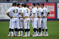 Michigan Wolverines team meeting before the second game of a doubleheader against the Siena Saints on February 27, 2015 at Tradition Field in St. Lucie, Florida.  Michigan defeated Siena 6-0.  (Mike Janes/Four Seam Images)