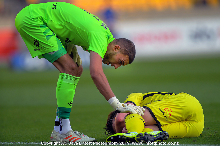 Brisbane goalkeeper Max Crocombe checks on Phoenix's Callum McCowatt during the A-League football match between Wellington Phoenix and Brisbane Roar at Westpac Stadium in Wellington, New Zealand on Saturday, 23 November 2019. Photo: Dave Lintott / lintottphoto.co.nz
