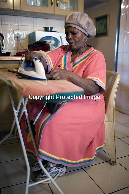JOHANNESBURG, SOUTH AFRICA - APRIL 14:Mamosadi Catherine Mlangeni, a victim of Apartheid does her laundry in her houseon April 14 2010, in Soweto, South Africa. Khulumanie is involved in the Daimler complaint brought forward by victims of Apartheid. Theplaintiffsargue that Daimler soldvehicles to the old South African government. (Photo by Per-AndersPettersson/Agentur Focus ForSpiegelMagazine)