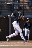 Evan Ocheltree (4) of the Wake Forest Demon Deacons follows through on his swing versus the Clemson Tigers during the first game of a double header at Gene Hooks Stadium in Winston-Salem, NC, Sunday, March 9, 2008.