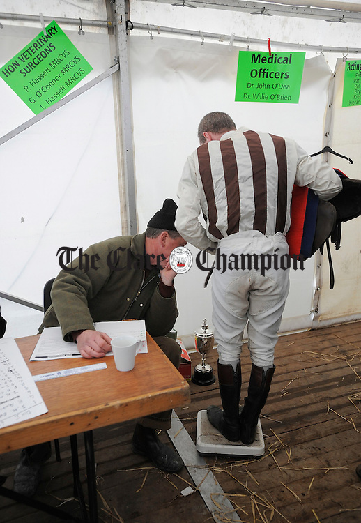 Kieran Shanahan checks the weights of the jockeys at Bellharbour Point to Point. Photograph by John Kelly.