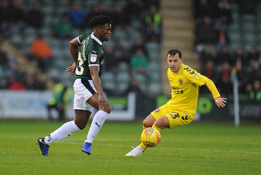 Plymouth Argyle's Ashley Smith-Brown under pressure from Fleetwood Town's Ross Wallace<br /> <br /> Photographer Kevin Barnes/CameraSport<br /> <br /> The EFL Sky Bet League One - Plymouth Argyle v Fleetwood Town - Saturday 24th November 2018 - Home Park - Plymouth<br /> <br /> World Copyright © 2018 CameraSport. All rights reserved. 43 Linden Ave. Countesthorpe. Leicester. England. LE8 5PG - Tel: +44 (0) 116 277 4147 - admin@camerasport.com - www.camerasport.com