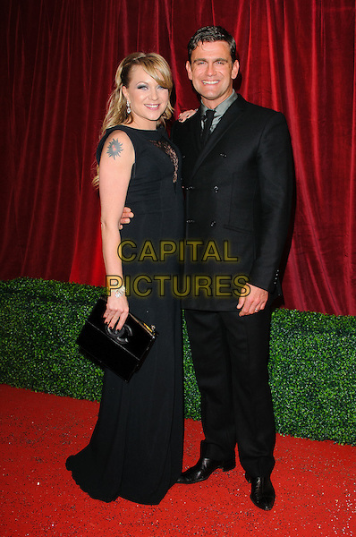 Rita Simons and Scott Maslen .British Soap Awards 2012, The London Television Centre, London, England..28th April 2012.full length black suit dress clutch bag tattoo.CAP/CJ.©Chris Joseph/Capital Pictures.