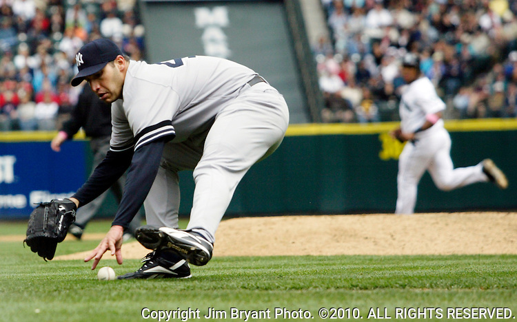 New York Yankees' Andy Pettitte reaches for a bunt hit by Seattle Mariners' Yuniesky betancourt in the forth inning at Safeco Field in Seattle on May 13, 2007.  (    Jim Bryant Photo. ©2010. All Rights Reserved