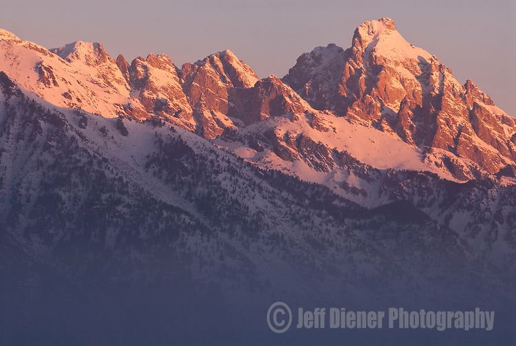 Sunrise paints the high peaks of the Tetons in Jackson Hole, Wyoming.