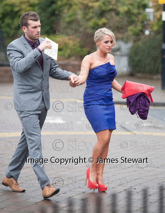 Kilmarnock keeper and his wife/partner arrive for the wedding of former teammate Steven Naismith and Moya Jane Farrell at the Brig O'Doon House Hotel, Alloway.