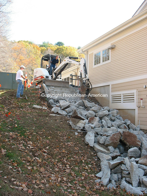 WOODBURY, CT - 26 October 2010 - 102610RH02 - Workers knock down a flight of stairs outside the Senior and Community Center in Woodbury. The architect, engineer and contractor have agreed to replace them after they began to crack last winter. Rick Harrison Republian-American