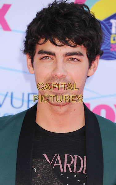 Joe Jonas.FOX's 2012 Teen Choice Awards held at The Gibson Ampitheatre in Universal City, California, USA..July 22nd, 2012.headshot portrait black grey gray jacket green.CAP/ROT/TM.©Tony Michaels/Roth Stock/Capital Pictures