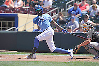 Omaha Storm Chasers Orlando Calixte (3) swings during the Pacific Coast League game against the Nashville Sounds at Werner Park on June 5, 2016 in Omaha, Nebraska.  Omaha won 6-4.  (Dennis Hubbard/Four Seam Images)