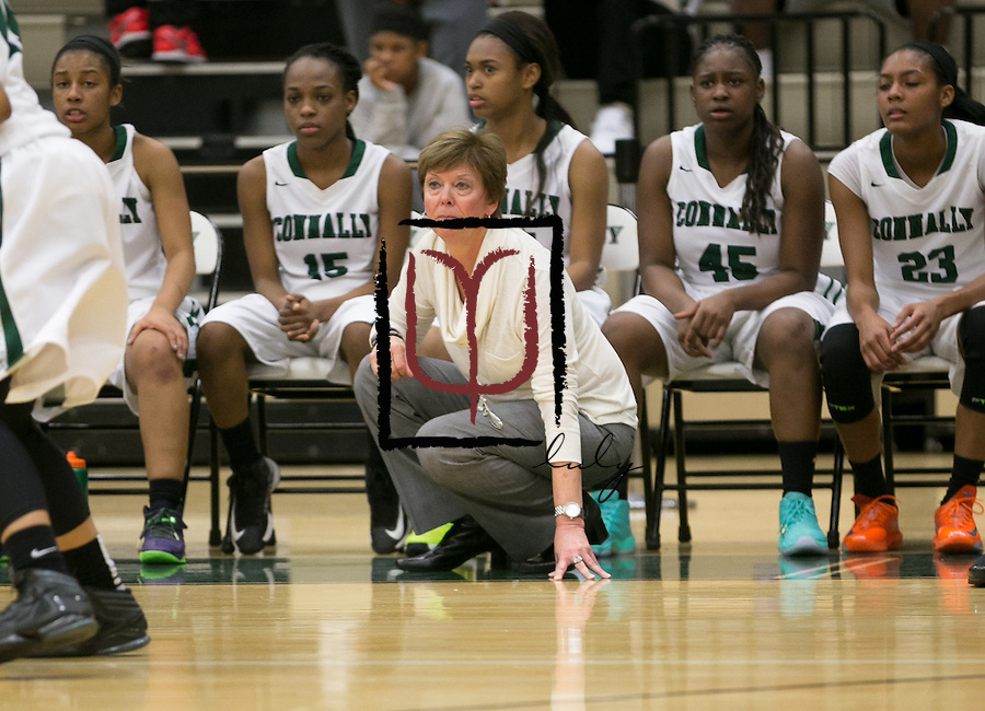 Connally head coach Candi Harvey watches her team compete against Hutto December 19, 2014 at home.  (LOURDES M SHOAF for Round Rock Leader.)