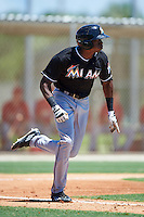 GCL Marlins center fielder Thomas Jones (33) runs to first base during the second game of a doubleheader against the GCL Cardinals on August 13, 2016 at Roger Dean Complex in Jupiter, Florida.  GCL Cardinals defeated GCL Marlins 2-0.  (Mike Janes/Four Seam Images)