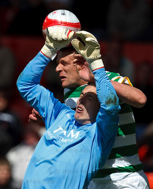 Jan Vennegoor of Hesselink tries to take Jamie Langfield from behind as he flaps at the ball