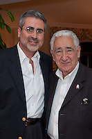 Jorge Pesquera, President and CEO of Palm Beach County Convention & Visitors Bureau; and Hal Herman, Chariman/Founding Editor at Worth International Media Group, at an intimate cocktail party hosted by National Geographic Traveler, held at Boca Raton Resort & Club, Boca Raton, Florida, USA, March 16, 2011. Photo by Debi Pittman Wilkey