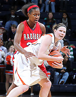 Dec. 6, 2010; Charlottesville, VA, USA; Virginia Cavaliers guard Lexie Gerson (14) gets tangled up with Radford Highlanders guard/forward Brooke McElroy (20) at the John Paul Jones Arena. Virginia won 76-52. Mandatory Credit: Andrew Shurtleff