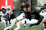 SIOUX FALLS, SD, NOVEMBER 26:  Kyle Groeneweg #11 from the University of Sioux Falls is is tripped up by Taylor Streeter #23 from Harding University Saturday afternoon at Bob Young Field in Sioux Falls. (Photo by Dave Eggen/Inertia)