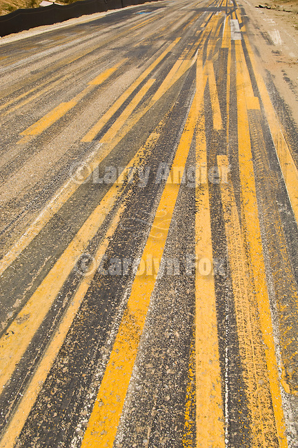 Road paint striping test area on a paved street