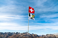 Swiss and Graubünden flags fly from a mountain hut above Pontresina, Switzerland