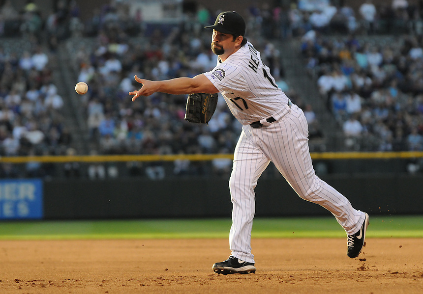 09 MAY 2011: Colorado Rockies first baseman Todd Helton (17) puts out a runner at first base during a regular season game between the New York Mets and the Colorado Rockies at Coors Field in Denver, Colorado. The Rockies beat the Mets 2-1. *****For Editorial Use Only*****