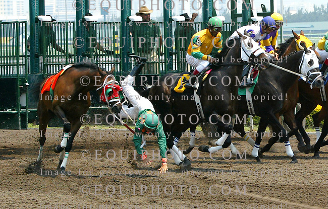 Jockey Elvis Trujillo falls off his mount Excellent Job #7, after stumbling from the gate in the first race at Gulfstream Park in Hallandale Beach, Florida on Thursday April 19, 2007.  Both horse and jockey were not hurt.  Photo By Justin Dernier/EQUI-PHOTO.