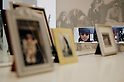 SAITAMA - DEC 5: A photo of John Lennon seen through family photos atop his famous white piano; John Lennon Museum, Tokyo. (Photo by Alfie Goodrich/Nippon News)