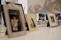 SAITAMA - DEC 5: A photo of John Lennon seen through family photos atop his famous white piano; John Lennon Museum, Tokyo. (Photo by Alfie Goodrich/Nippon News)