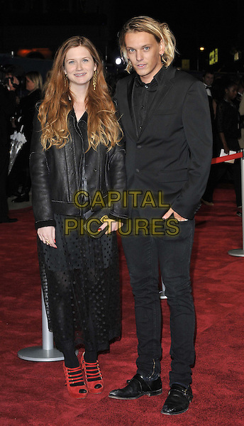 Bonnie Wright & Jamie Campbell Bower .'360' opening gala premiere, 55th BFI London Film Festival, Odeon cinema, Leicester Square, London, England..October 12th 2011.full length black dress suit couple leather jacket sheer red straps tights peep toe shoes clutch bag.CAP/CAN.©Can Nguyen/Capital Pictures.