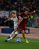 Marcos Llorente of Real Madrid  and Rick Karsdrop of AS Roma  during the Champions League Group  soccer match between AS Roma - Real Madrid  at the Stadio Olimpico in Rome Italy 27 November 2018